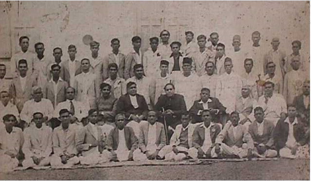 Dr. Ambedkar with prominent social workers of the Independent Labour Party at Bombay in 1936. Seen in the second row (seated) are Mr. R. R. B0le, Advocate Gadkari. Dr. Ambedkar, Nanasaheb Tipnis of Mahad. Behind them are Mr. Ganpat Mahadev Jadhav (in cap) and on his left is Mr. Ramakrishna Bhatankar, the then MLA of Bombay Legislative Assembly