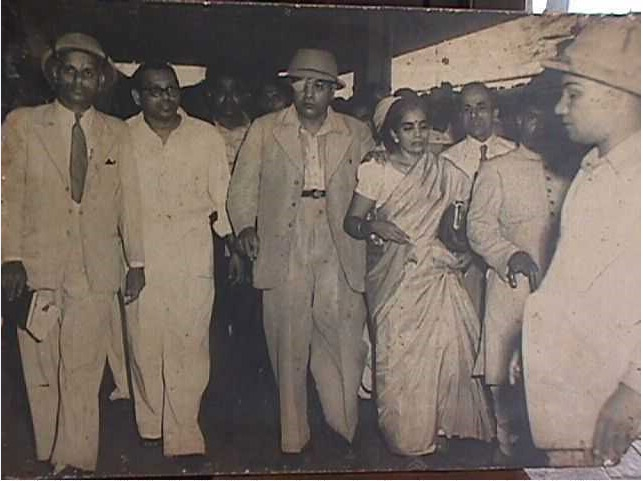 Dr. Ambedkar with his wife Mrs. Savita Ambedkar after his cataract conducted at Delhi in 1953. Seen from left are Principal of Siddharth College- Mr. Patankar. Mr. Mukundrao Ambedkar (nephew of Dr. Ambedkar), Mr. Balu Kabir and Mr. J. G. Bhatnagar, General Secretary of the Scheduled Caste Federation, Bombay Pradesh, Ex MLA and also the then president of Municipal Kamgar Sangh, Bombay